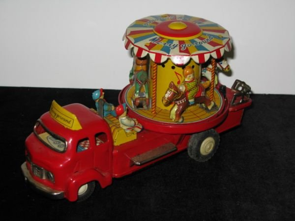 "218: JAPAN TIN LITHO ""MERRY GO ROUND"" TRUCK"