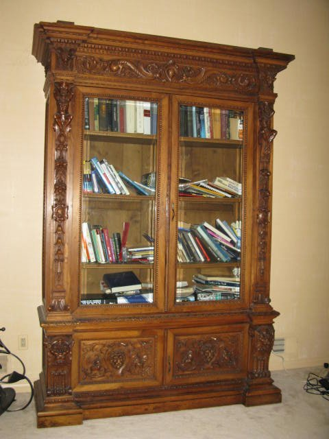 111: HEAVILY CARVED OAK BOOKCASE, GARGOYLES