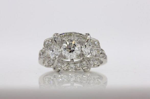 274: 14K LADIES PLATINUM DIAMOND RING. .69 CT. WT.
