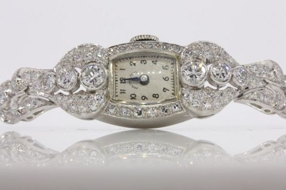 275: LADIES PLATINUM & DIAMOND WATCH, 68 DIAMONDS.