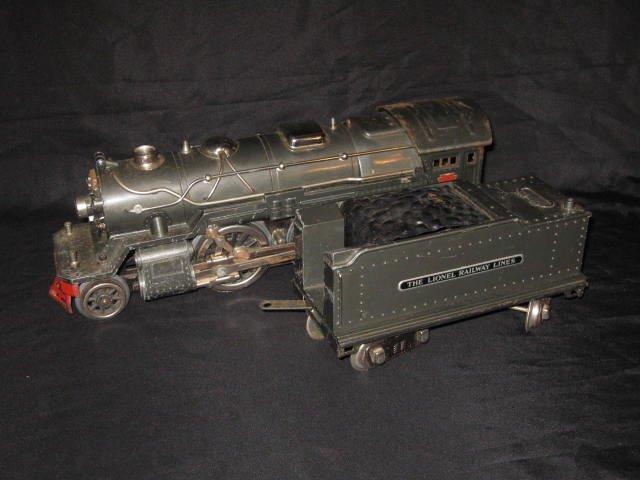 240: LIONEL STEAM ENGINE & COAL CAR