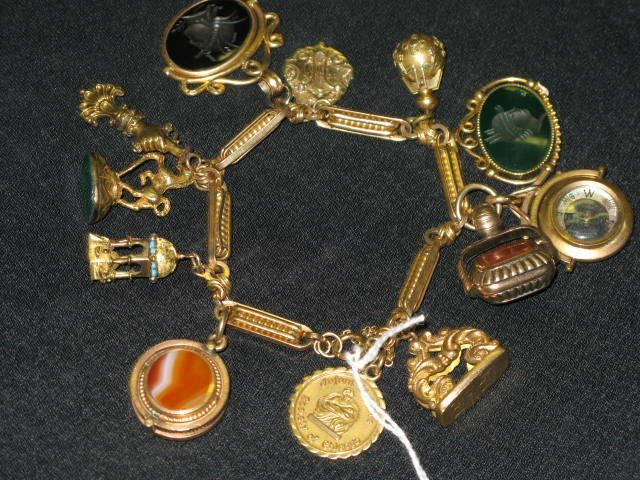60E: CHARM BRACELET,  APP. 97.6 GRAMS 14KT TOTAL WEIGHT