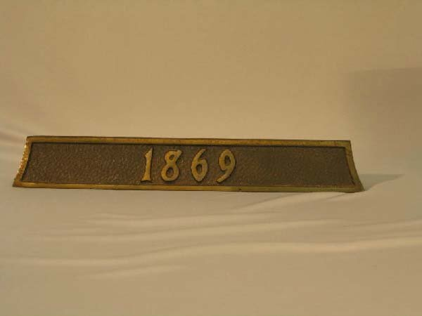 "6: BRASS YEAR MARKER ""1869"""
