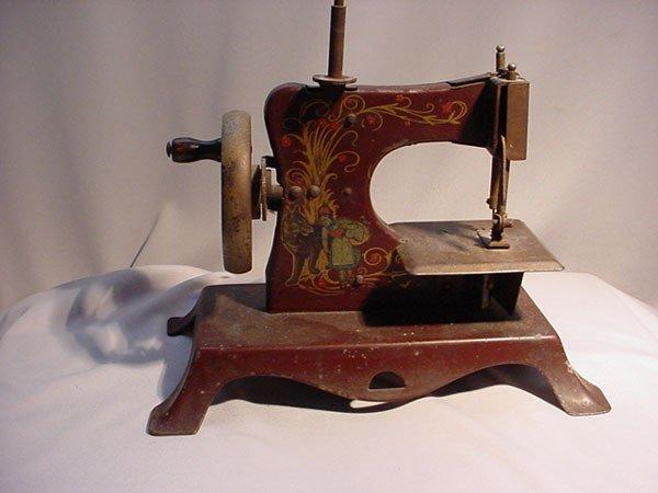 "20: GERMAN TOY SEWING MACHINE ""RED RIDING HOOD"""