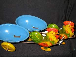 2 TIN LITHOGRAPHED ROOSTERS PULLING CARTS