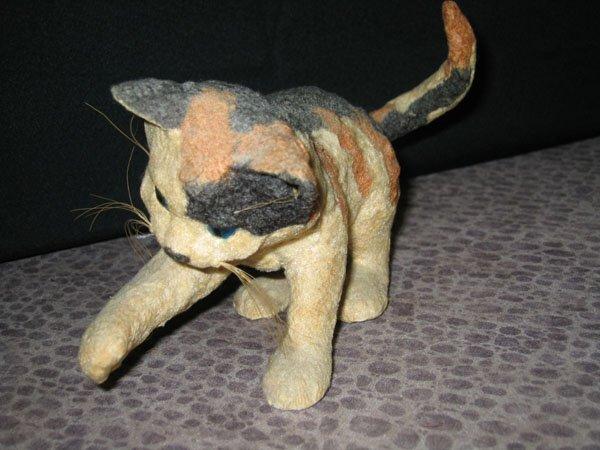 412: CALICO CAT COVERED W/FELT MATERIAL. PLASTIC