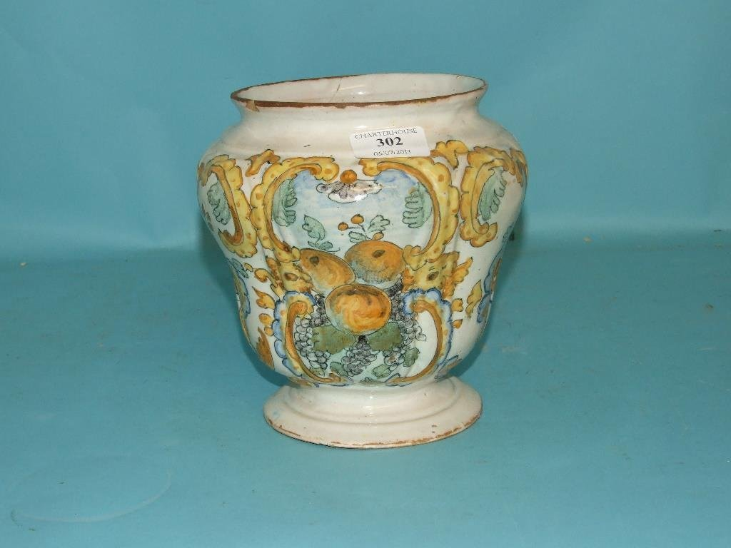 An Italian maiolica jar, decorated fruit, bears a date
