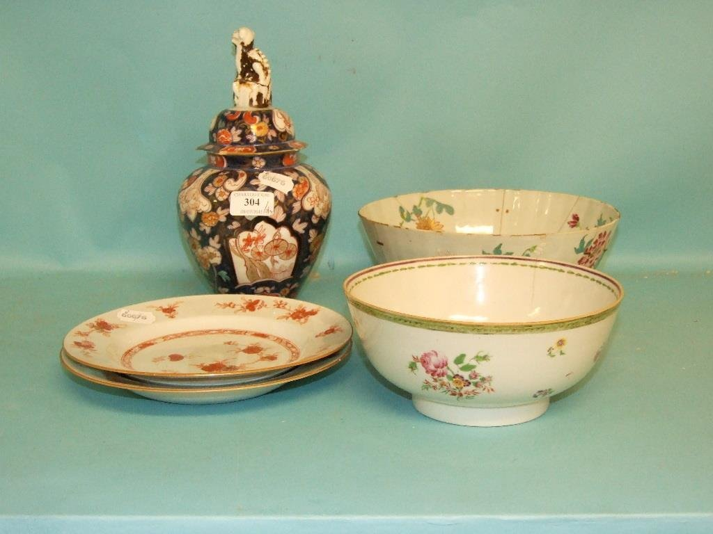 A Japanese jar and cover, two Chinese plates, decorated