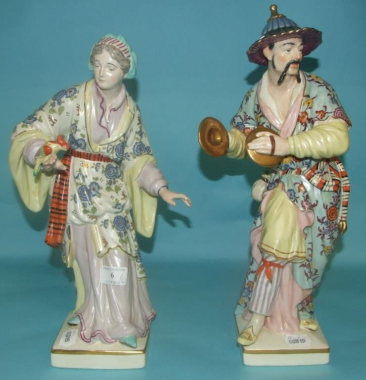 A pair of figures of an oriental gentleman and