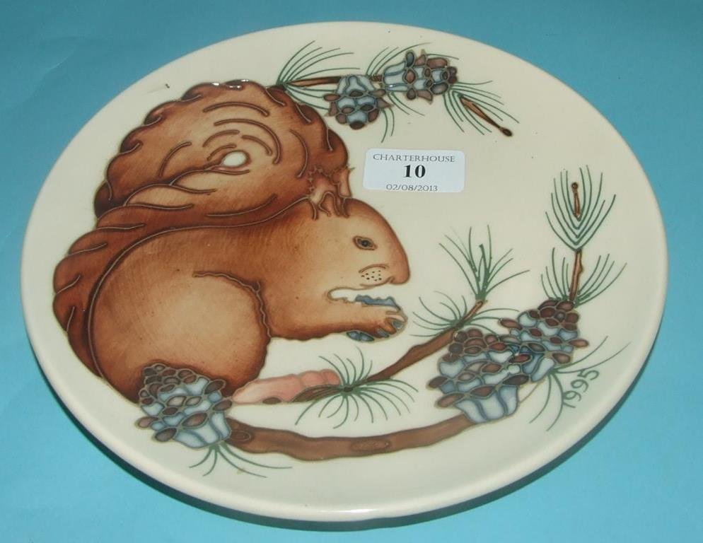 A Moorcroft pottery limited edition plate, decorated a