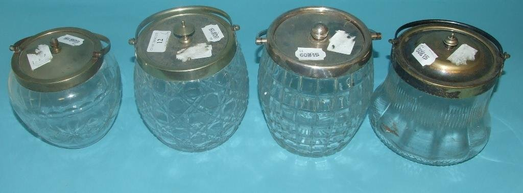 Four cut glass biscuit barrels, with plated mounts (4)