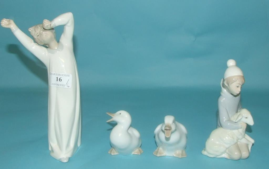 A Lladro group, of a child with a lamb, 14.5 cm high, a