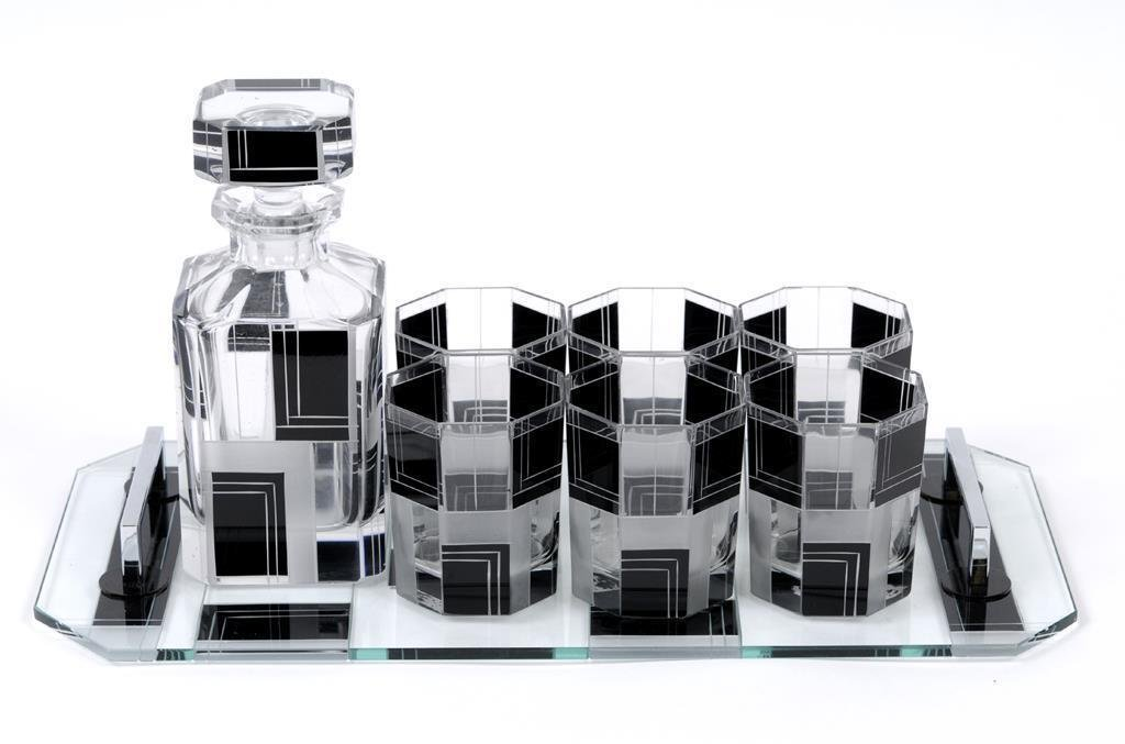 An Art Deco style black and clear glass decanter, six
