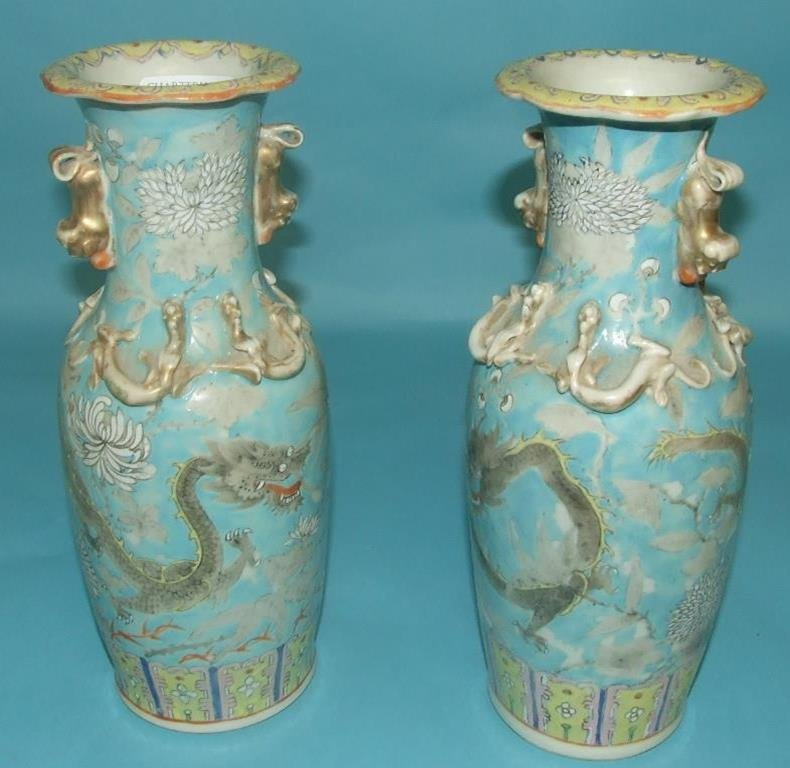 A pair of Chinese porcelain vases, decorated dragons,