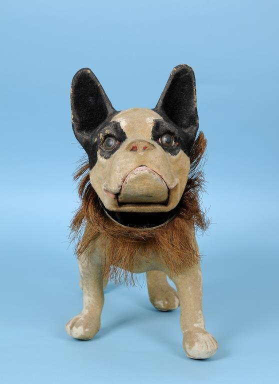 A child's French bulldog pull along toy, with a nodding