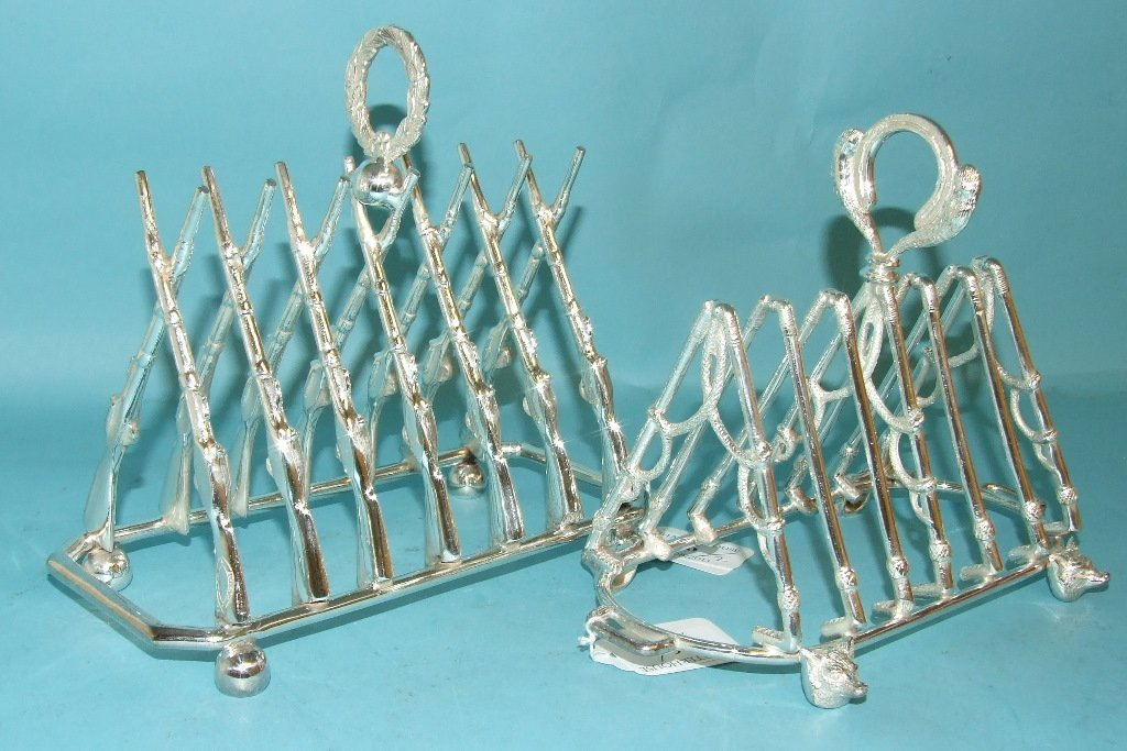 A pair of hunting themed toast racks (2)