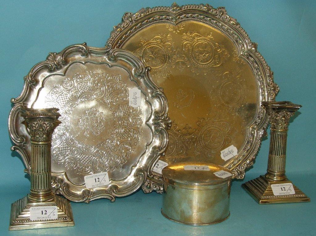 A pair of silver plated Corinthian column candlesticks,