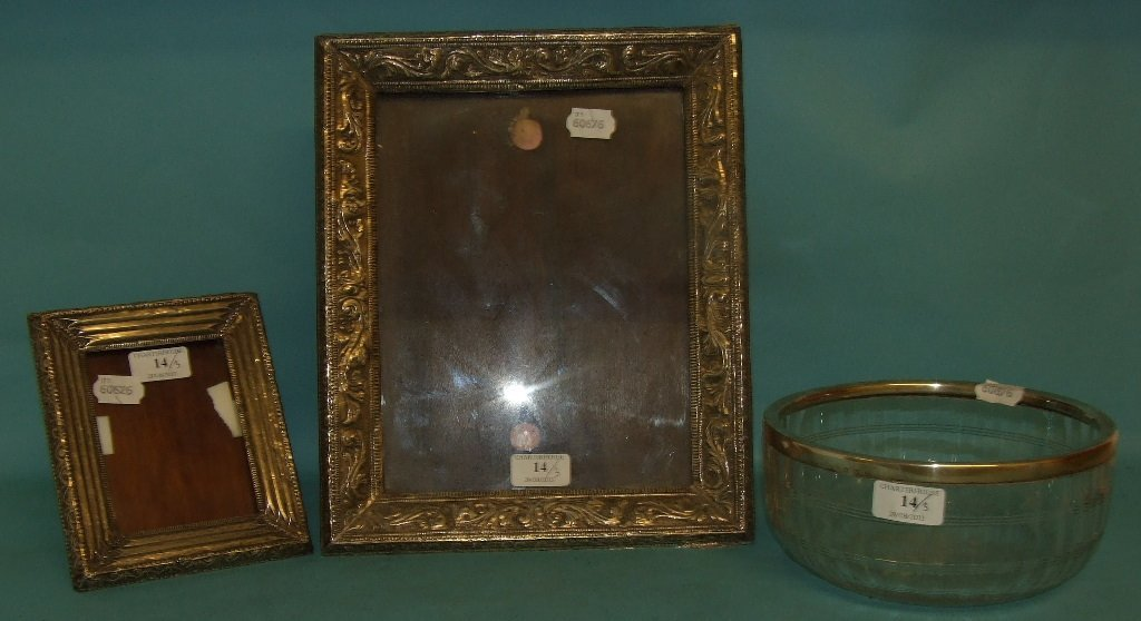 A silver coloured metal mounted photograph frame,