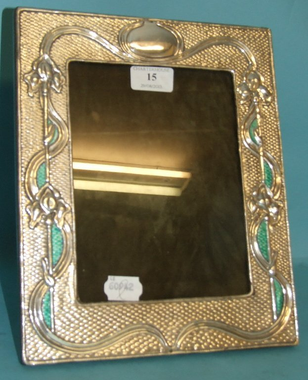 A silver and enamel style frame, 24 cm wide