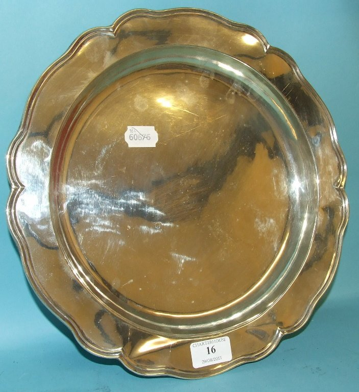 A Chilean silver coloured metal salver, with a shaped