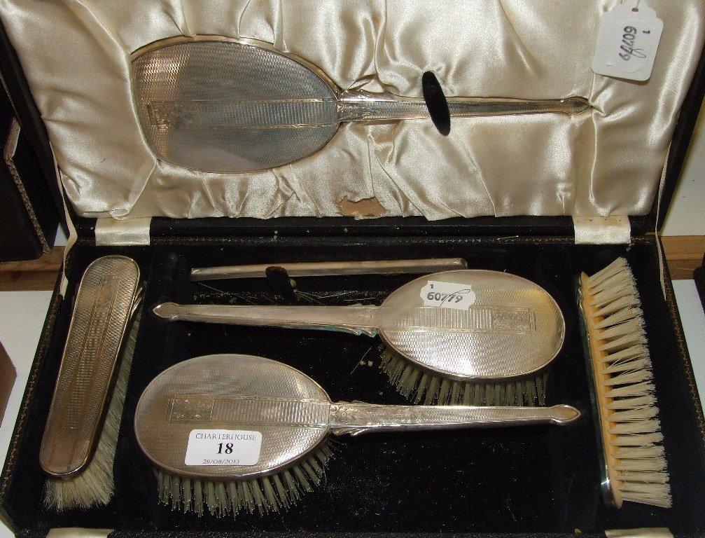A silver dressing table set, Birmingham 1952/54/55,
