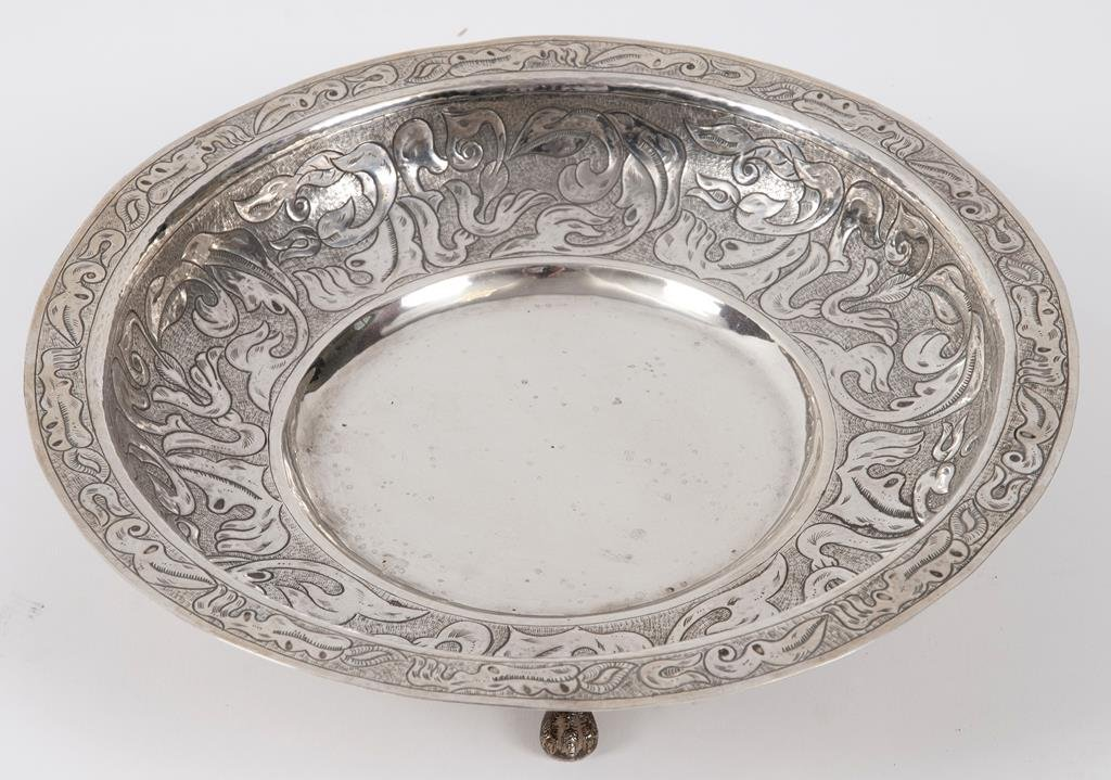 A Chilean silver coloured metal dish, with embossed