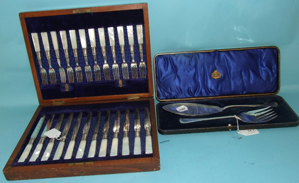 A pair of silver plated fish servers, and a set of