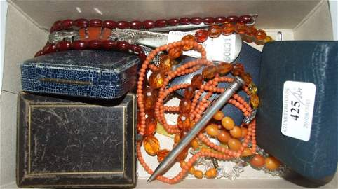 A string of amber style beads, a silver vesta case, a