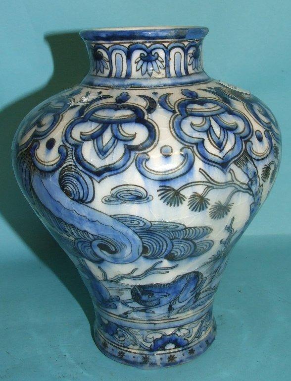 An Iznik style vase, decorated in underglaze blue, 19.5