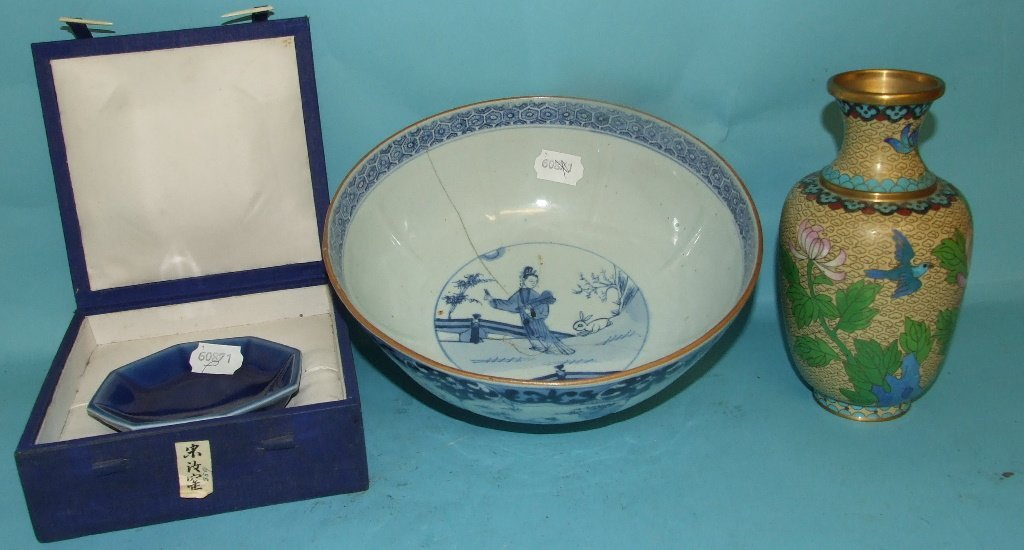 A Chinese porcelain bowl, decorated panels of figures,