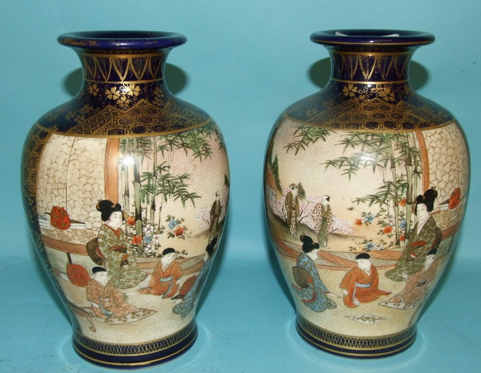 A pair of Japanese Satsuma vases, decorated figures,