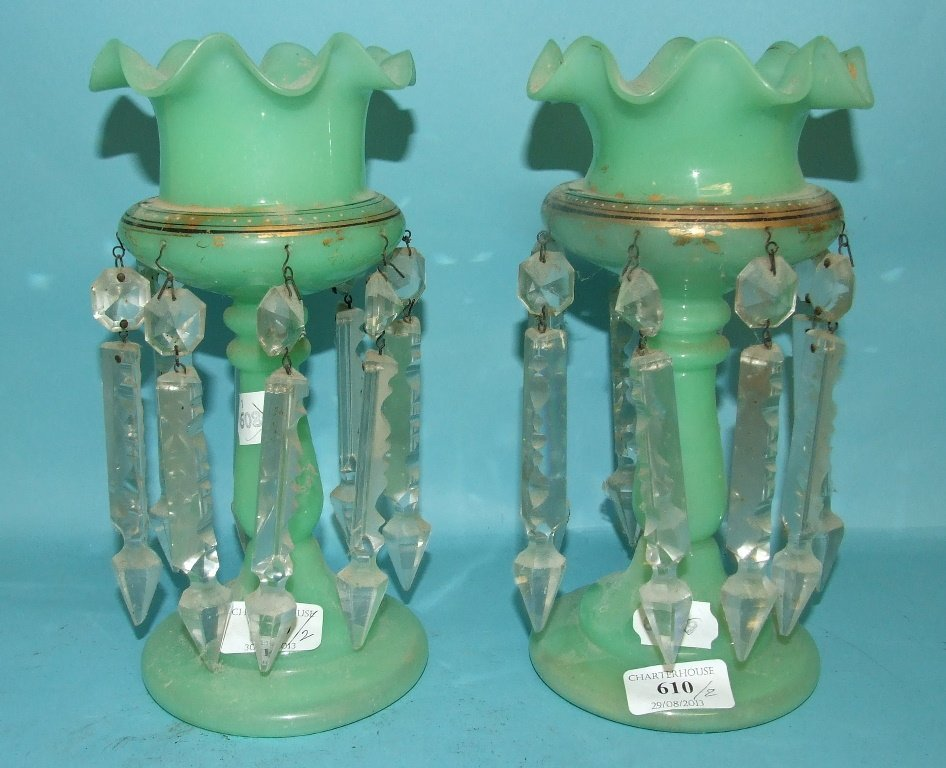 A matched pair of green glass lustres, with gilt