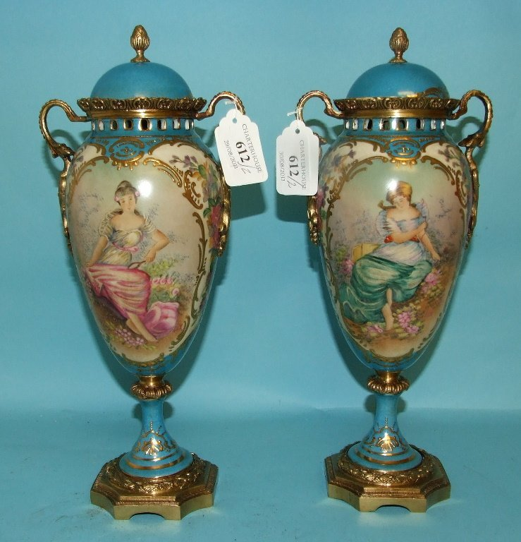 A pair of Sevres style vases, decorated figures, 32 cm