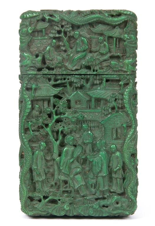 A Chinese carved ivory card case, stained in green,