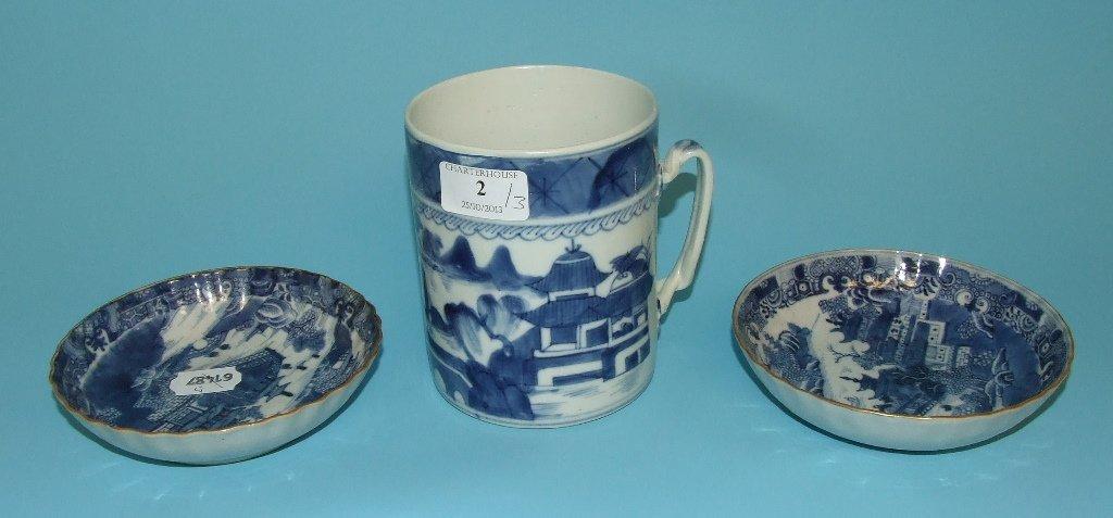A Chinese cylindrical mug, decorated in underglaze