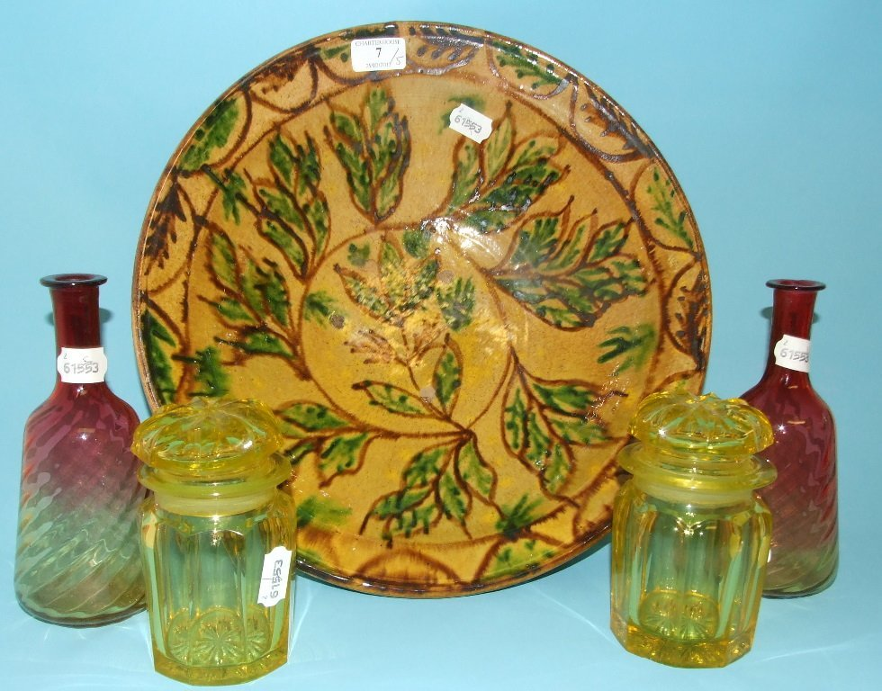 An earthenware bowl, decorated foliage, 38 cm diameter,