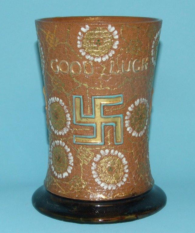 A Royal Doulton stoneware mug, Good Luck, decorated
