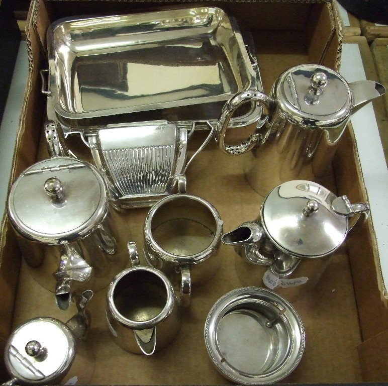 A silver plated entree dish, a five piece silver plated
