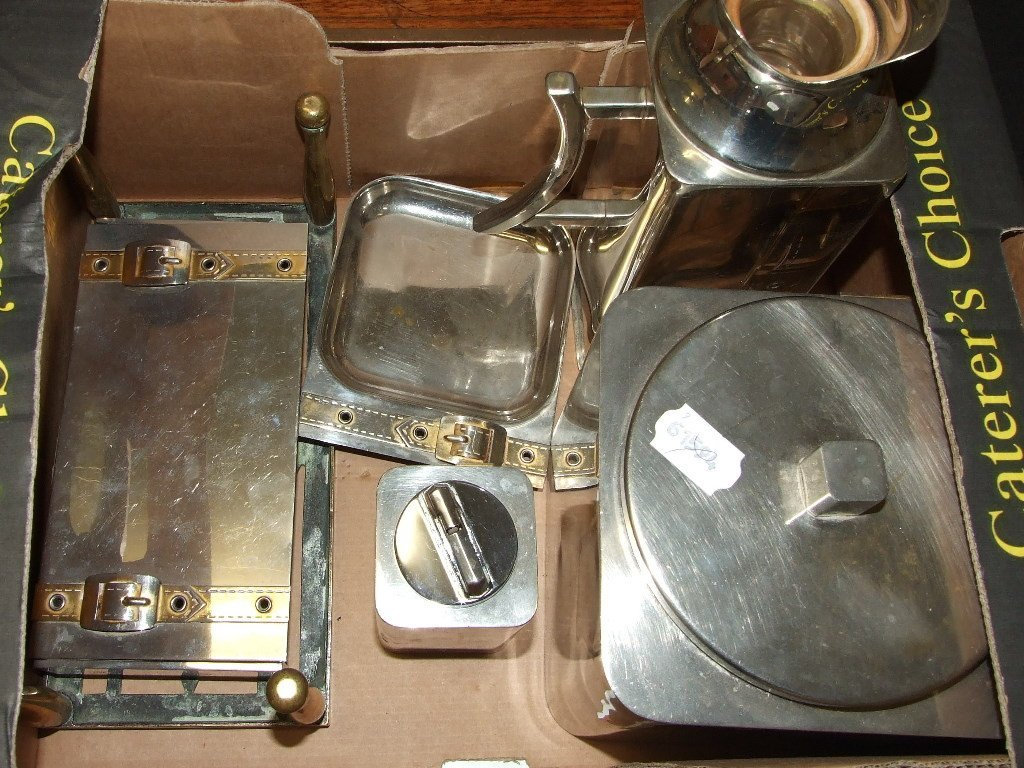 A silver plated biscuit barrel, other similar items,