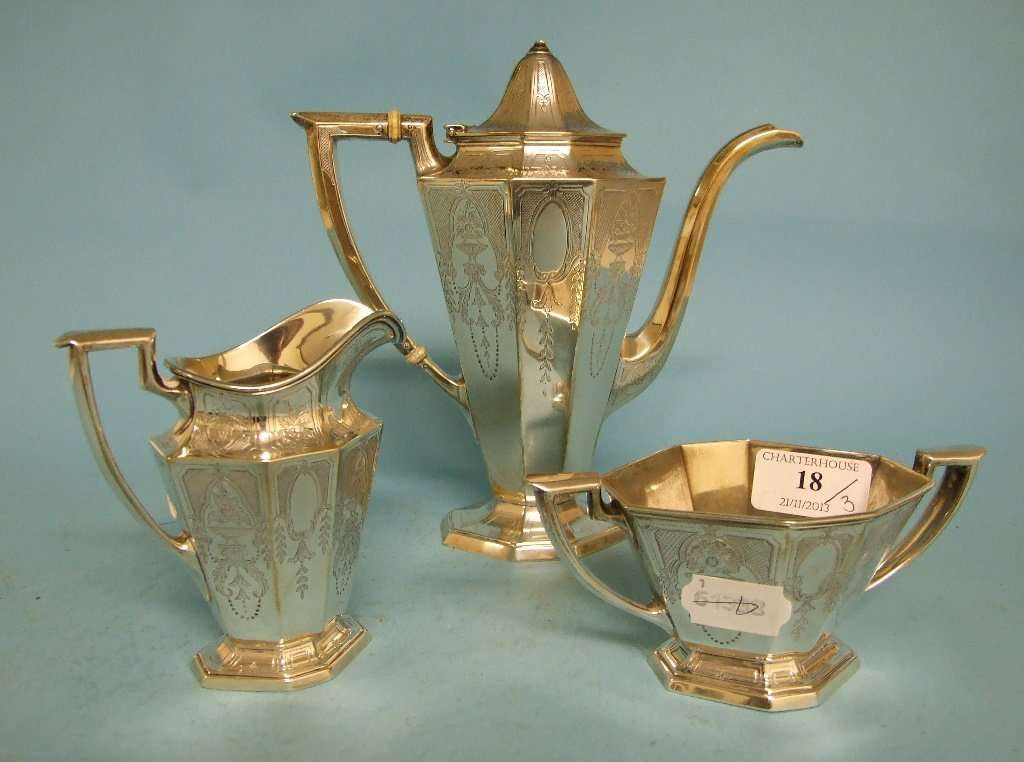 A sterling silver three piece coffee set, with engraved