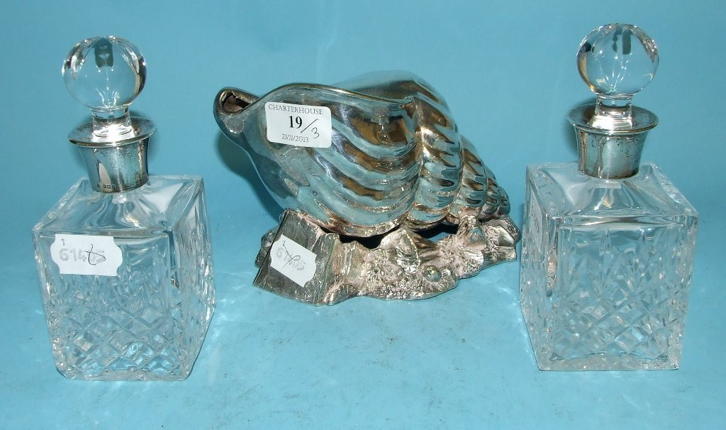 A silver plated spoon warmer, in the form of a shell,