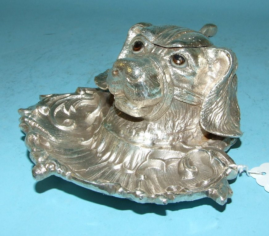 An inkwell, in the form of a dog, 14 cm wide