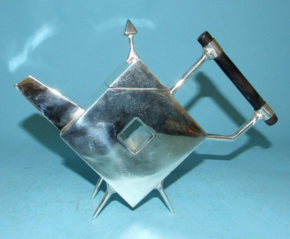 A Christopher Dresser style teapot, 25 cm wide