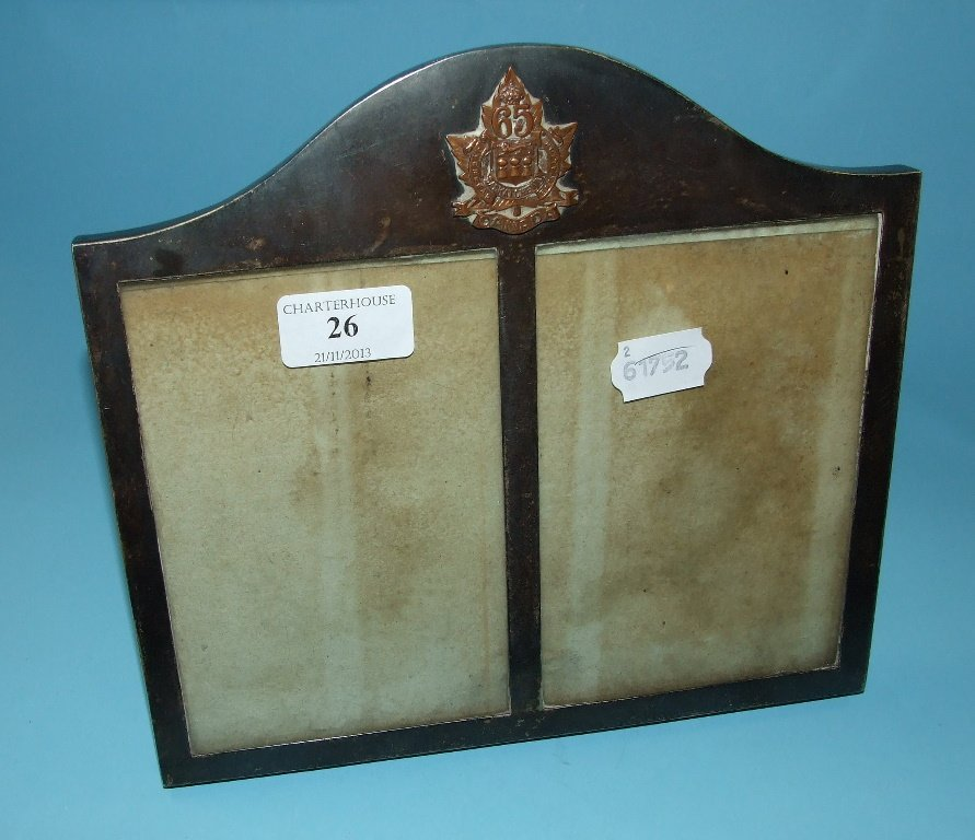 A silver mounted double photograph frame, with a