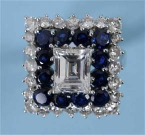 An 18ct white gold, sapphire and diamond ring, the