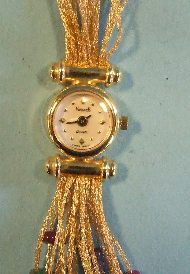 A lady's 18ct gold cocktail watch, with an integral