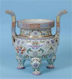A Chinese famille rose tripod censer, the rim with an