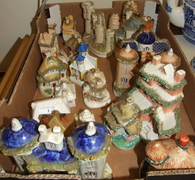 A Staffordshire pottery money box, in the form of a