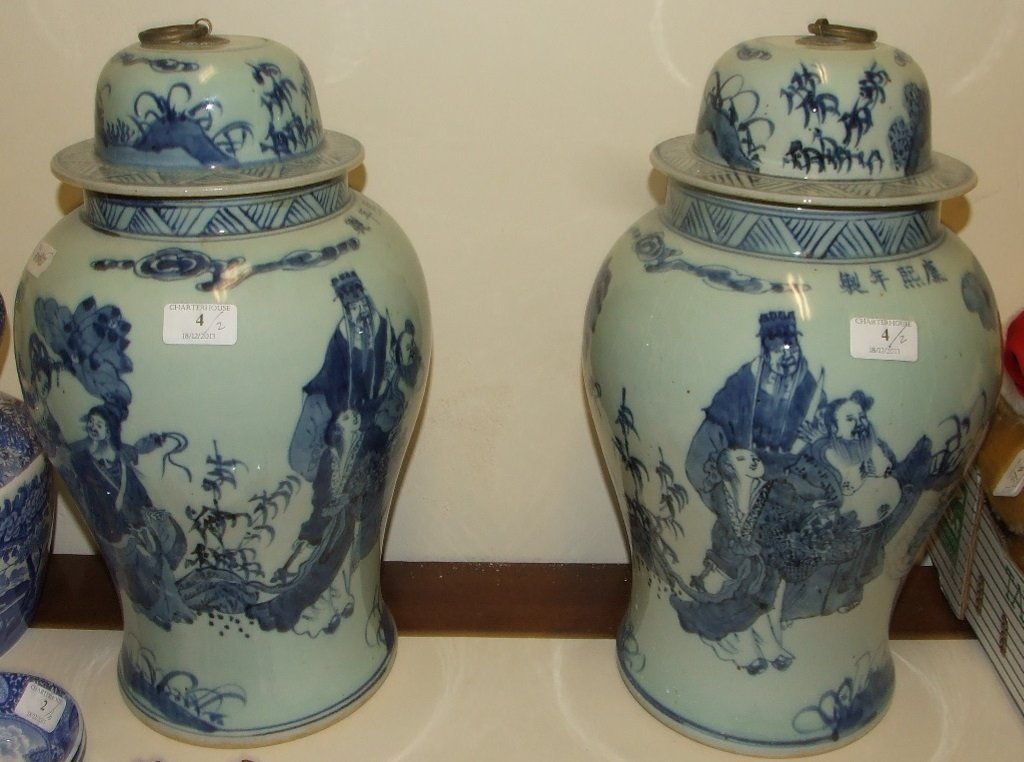 A large pair of vases and covers, decorated figures in