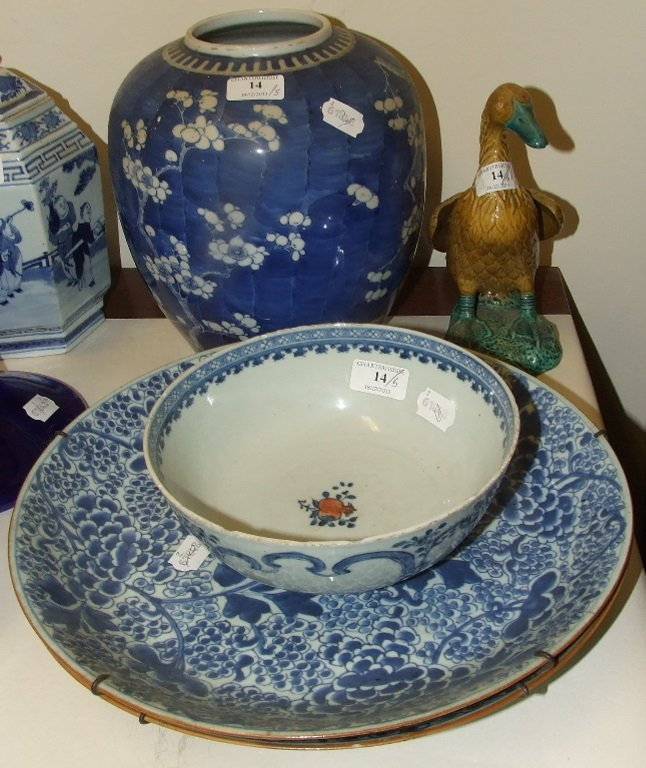 A Chinese porcelain bowl, 20.5 cm diameter, two similar